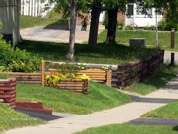 how to make use of landscape timbers for a garden retaining wall