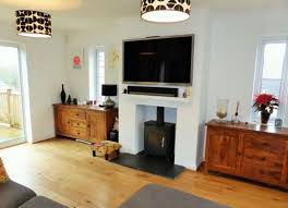 image result for installing a tv over a wood burning stove