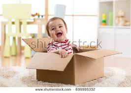 happy infant baby boy spoon eats stock photo 631322687