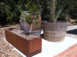 Half Barrel Planters by Rusty Steel Planter Box Half Wine Barrel Used As A Pond Full