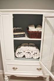 Wicker Bathroom Shelf Bathroom Cabinet Via Wickerparadise Bathroom Wicker Cabinet