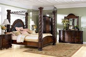Ashley Signature Bedroom Furniture Brown Cherry Hand Carved Post Bed From Ashley Signature