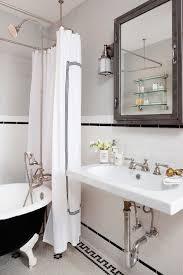 traditional black and white bathroom features gray upper walls