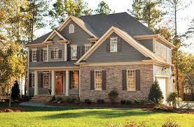 grey siding with tan brick instead of stone and cream trim do