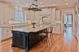 white kitchen cabinets with black island zillow digs trend report traditional kitchens islands