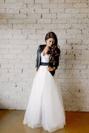 wedding dress jacket picture of tulle wedding dress with a black sash and a black jacket