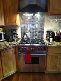 Kitchen With Stainless Steel Backsplash My New Wolf Range With 2x2 Inch Stainless Steel Tile Backsplash