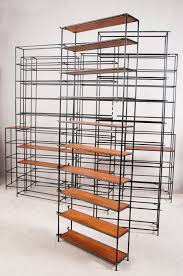 poul cadovius teak glass and enameled metal modular shelving for