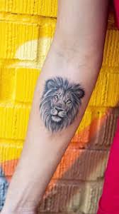 lion tattoo smaller and different placement though lion tattoo