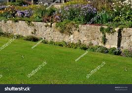 stone wall traditional english garden stock photo 86641630