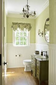 Powder Room Powell Ohio - traditional powder room with wood counters pendant light wall