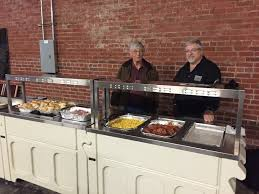 trinity funeral home serves buffet breakfast to homeless