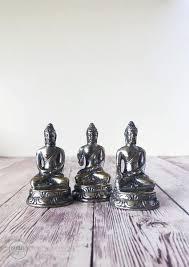 trio of silver buddha statues mala earth