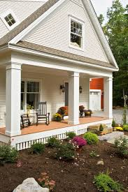 front porch columns exterior craftsman with gray siding hanging plants