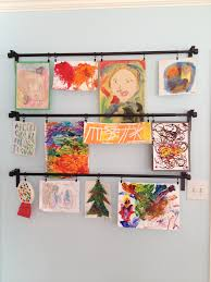 children u0027s art displayed with ikea curtain rods craft ideas