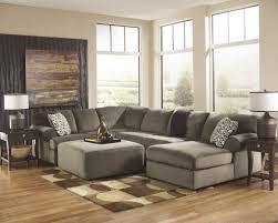 Place Area Rug Living Room Living Room Grey Sectional Sofa Chandelier Black Cabinet