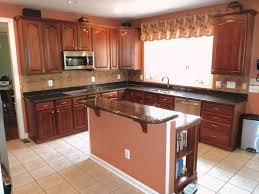 Baltic Brown Granite Countertops With Light Tan Backsplash by Kitchen Dark Brown Granite Countertops Best Marble Ki Brown