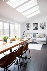 modern living room and kitchen combo with industrial touches industrial kitchen roof extension skylight modern living room light gray sofa lounger butcher block dining