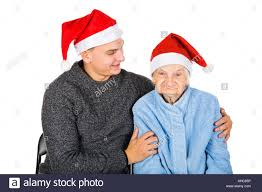 what to get an elderly woman for christmas picture of an elderly woman with a christmas hat stock photo