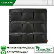 green field vertical garden with self watering irrigation system