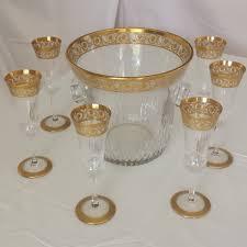 porte seau a champagne sur pied seau et flutes à champagne en cristal de saint louis thistle or