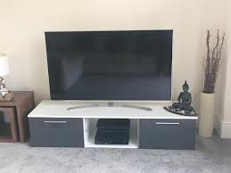 white and grey gloss tv unit with led backlight in exeter devon