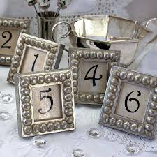 silver wedding table numbers details in the decor table numbers in silver boules mini frames for