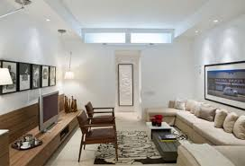long narrow living room with long sofa and floor cabinet for tv