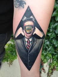 magritte inspired twin peaks tattoo done by john embry in bowling