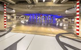parking garage lighting levels empty driveway in circular underground parking garage with colorful