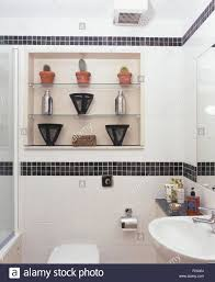 Modern White Bathrooms by Black Mosaic Tiled Border In Modern White Bathroom With Glass