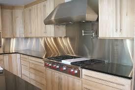 stainless kitchen backsplash stainless steel backsplash white cabinets white counter top built in