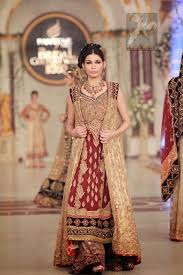 wear maroon fawn bridal gown and sharara