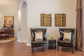 executive style home in westchase staged with warm colors