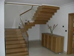 modern timber stairs with stainless steel and glass balustrades