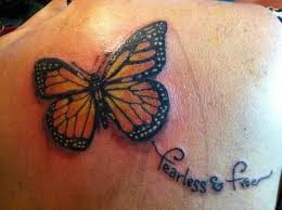 fearless free butterfly on upperback tattooshunt com