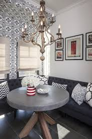 dining room white dining banquette wit white round table plus