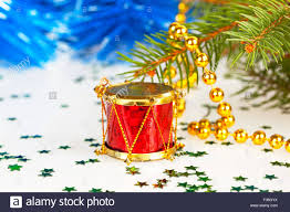 red drum under the tree with gold beads stock photo royalty free