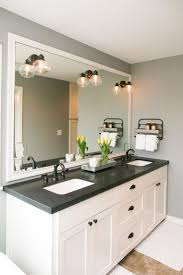 black bathroom cabinets with white and grey counter top and black