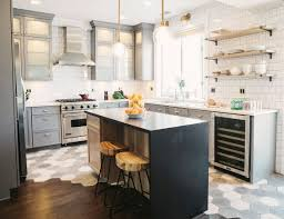 grey kitchen cabinets brass gold hardware pulls knobs square tile
