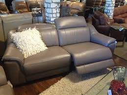 htl carrera power reclining sofa with adjustable headrests is