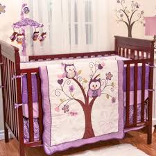 contemporary plum coloured bedroom with dark brown wood baby