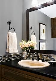 inexpensive bathroom tile ideas mosaic tile border and black framed mirror with the gray blue walls