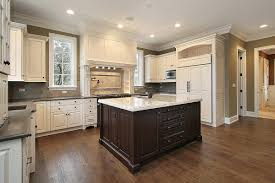 beautiful kitchen with quartz counter island white cabinets and