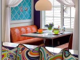 rectangular table placemats curtain orange cushions window lime