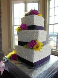 eggplant ribbon 3 tier square offset buttercream cake w fresh flowers and eggplant
