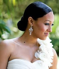 a long necklace makes a perfect match with a one shoulder dress