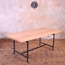 metal pipe legs industrial style dining table by cosywood