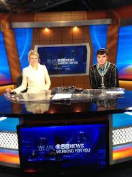eric with cbs 58 u0027s jennifer tomazic on the news anchor desk