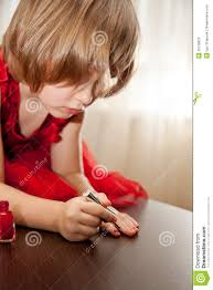 little in a red dress painted nails with nail polish stock
